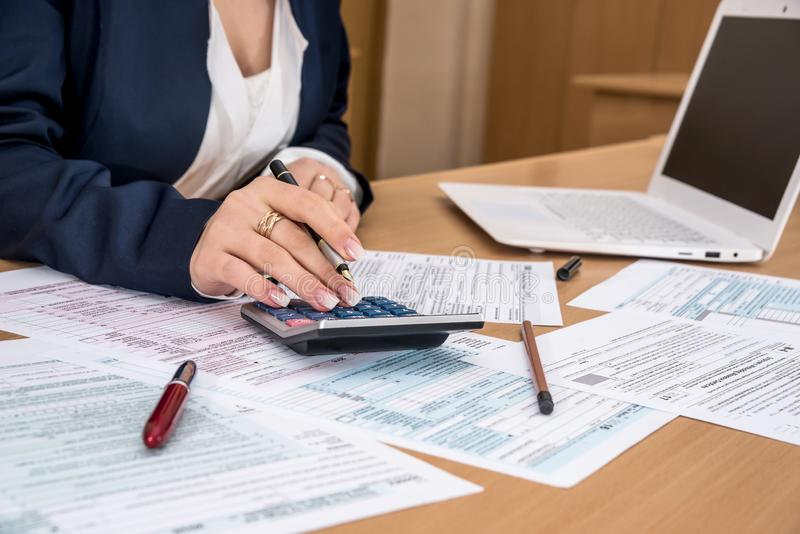 Woman filling US tax form.  stock images