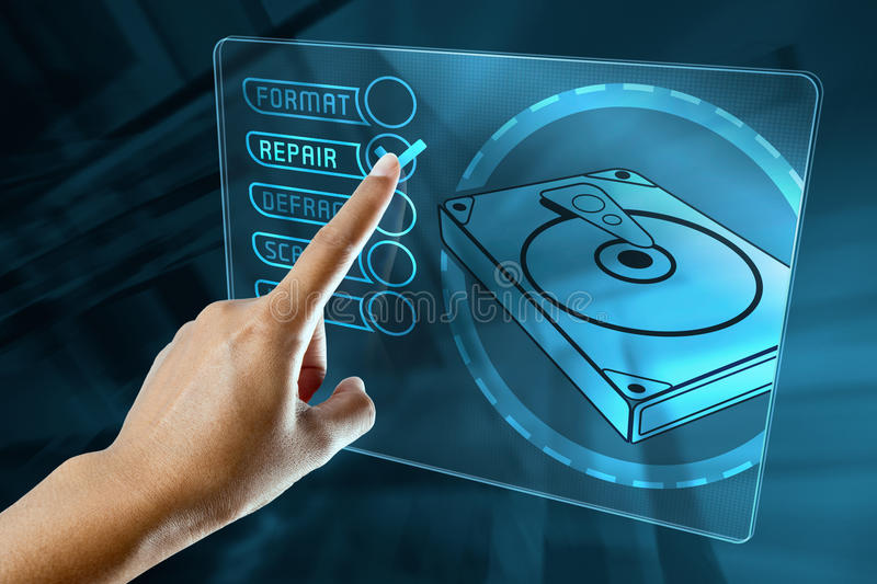 A woman finger choice the option to repair a hard disk royalty free stock photo
