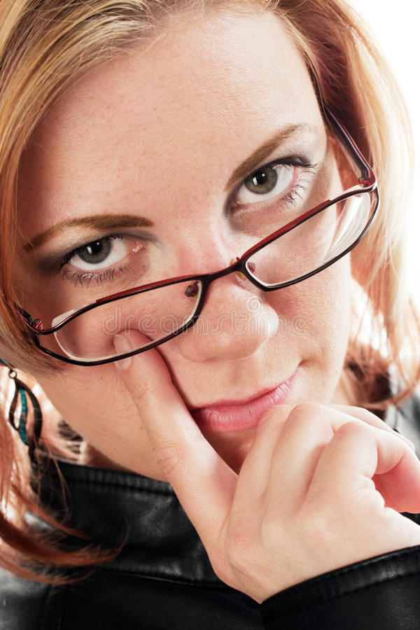 Woman with finger on the eye stock photography