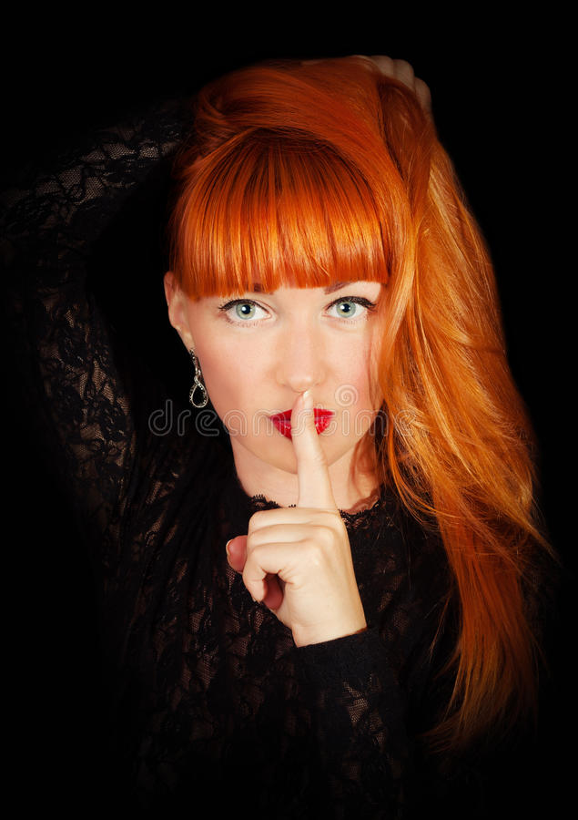 Woman with Finger on her Red Lips stock image