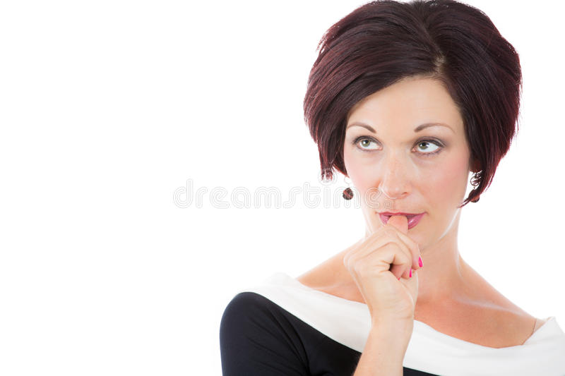 Woman with finger in mouth sucking thumb or biting fingernail in anxiety,stress, or bored and clueless