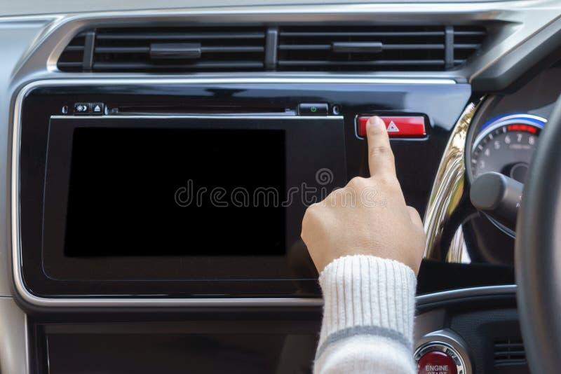 Woman finger pressing emergency button on car dashboard. Woman finger pressing emergency button on car dashboard royalty free stock photos