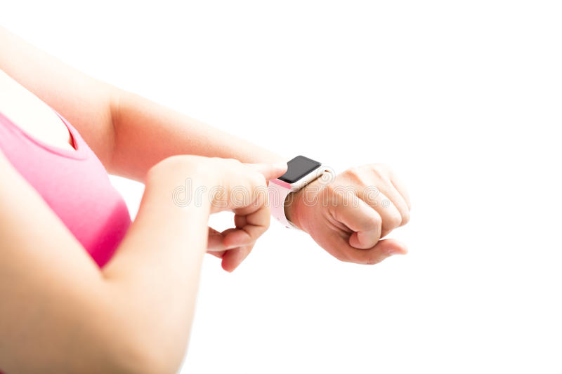 Woman finger touch the sports smart watch. Young woman finger touch the sports smart watch royalty free stock images