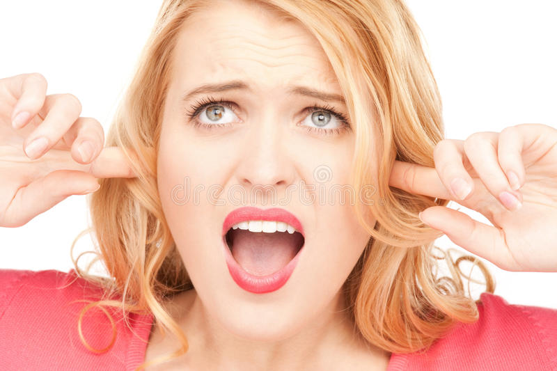 Download Woman with fingers in ears stock image. Image of desperate - 20069837