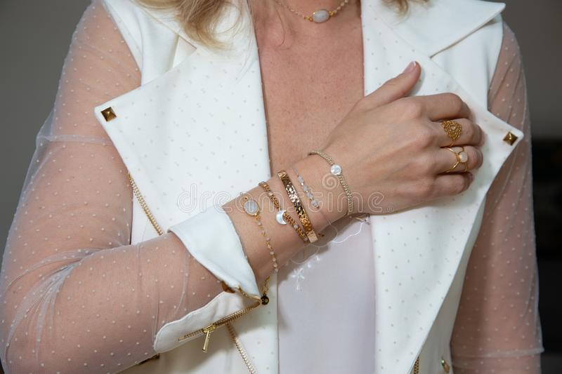 Woman fingers hands with gold bracelets and ring royalty free stock photography