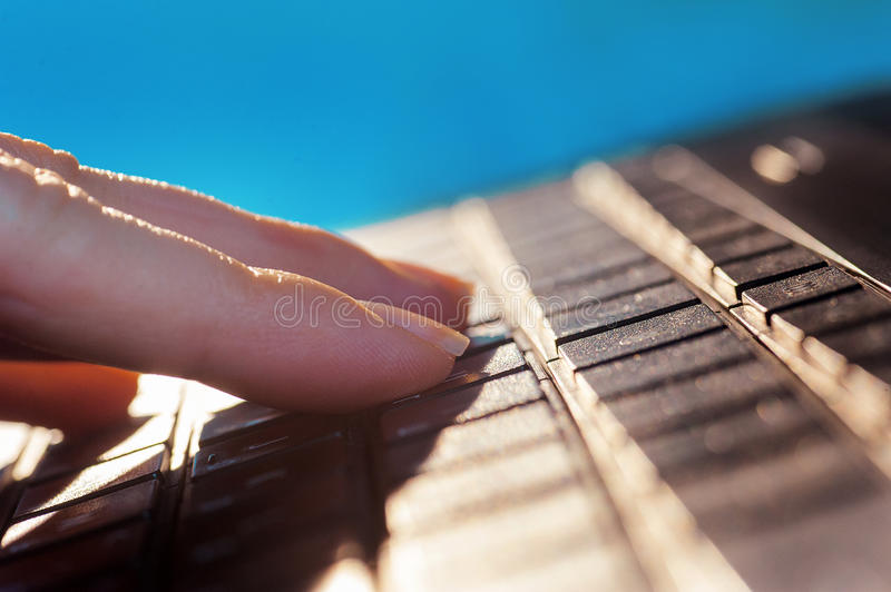 Woman fingers on the keyboard of notebook royalty free stock photography