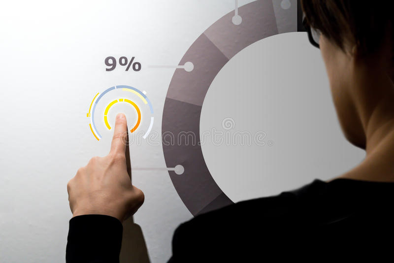 Woman fingers pointing graphic diagram on digital wall. Business info graphic interface design concept royalty free stock image