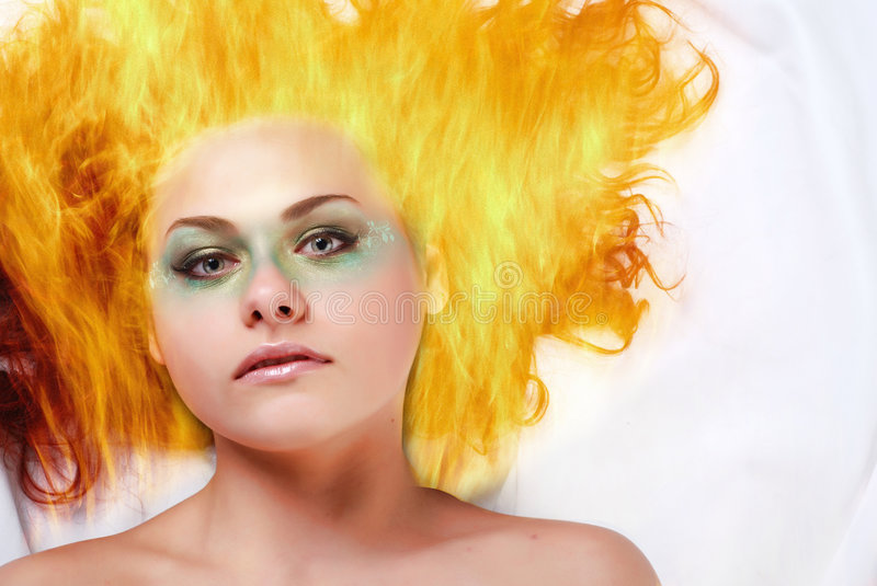 Woman with fire hair. Portrait if a beautiful young woman with fire hair stock photo