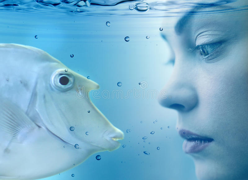 Woman and fish. Under water