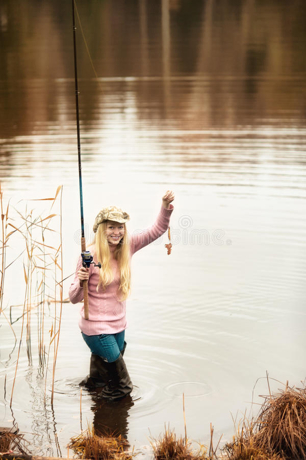 Download Woman Fishing stock photo. Image of photo, adult, grass - 24345128