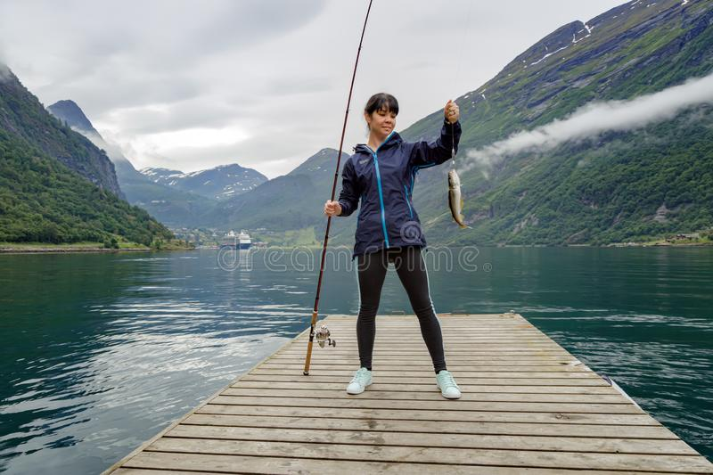 Woman fishing on Fishing rod spinning in Norway royalty free stock images