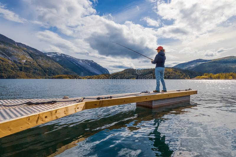 Woman fishing on Fishing rod spinning in Norway stock photography