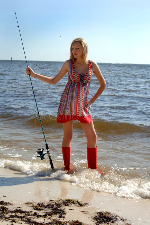 Woman fishing portrait stock photo