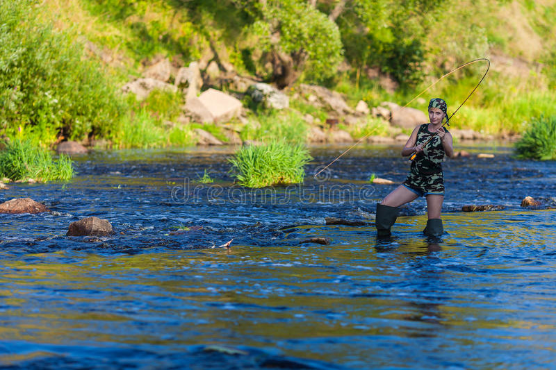 Woman fishing portrait royalty free stock photography