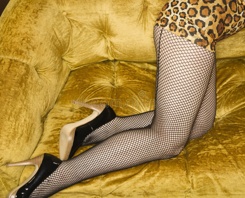 Woman in fishnet stockings. stock photo