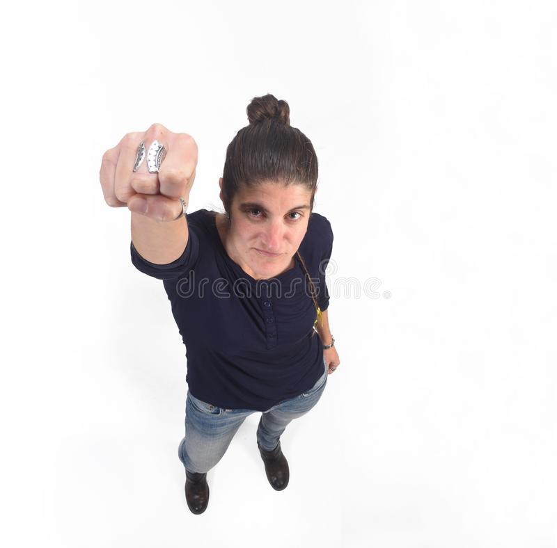 Woman with fist raised on white.  royalty free stock photos
