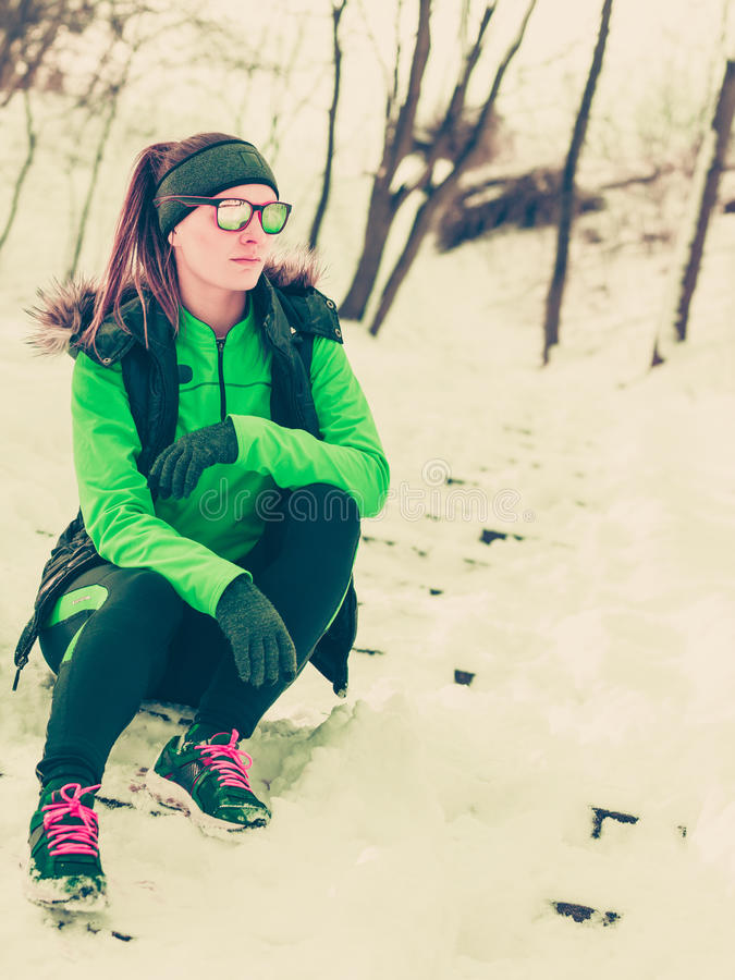 Woman fit sport model training outdoor on cold day. Sports activity in winter time, healthy lifestyle concept. Fit woman athlete girl training outdoor wearing stock photos
