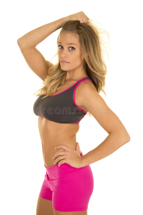 Woman in fitness attire side pull hair royalty free stock images