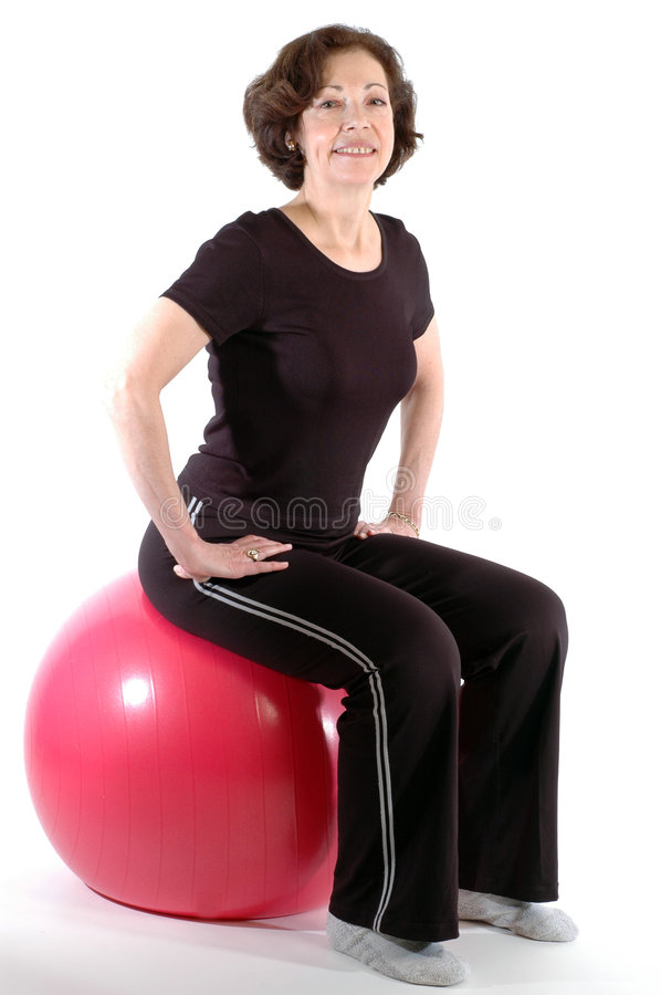 Woman on fitness ball royalty free stock photos