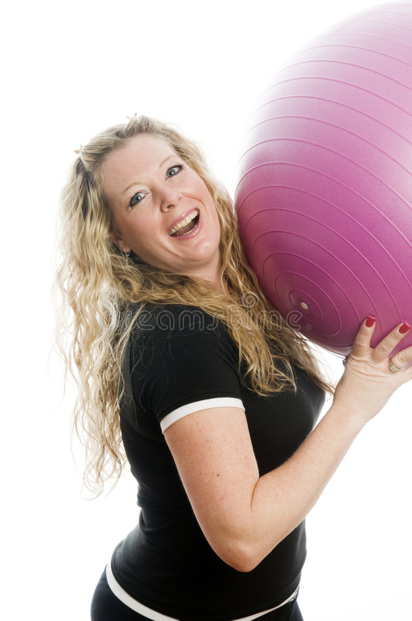 Woman with fitness ball royalty free stock photography