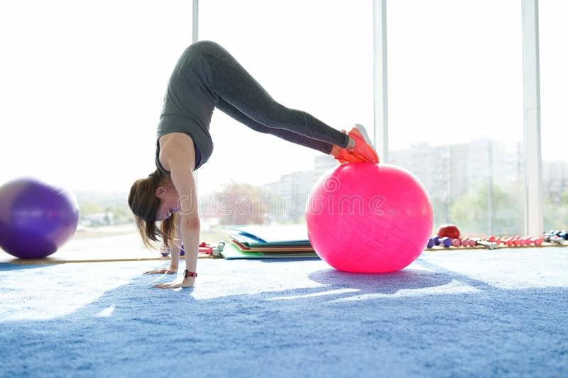 Woman fitness. beautiful Caucasian senior woman doing exercise with ball in gym . healthy lifestyle.  stock images