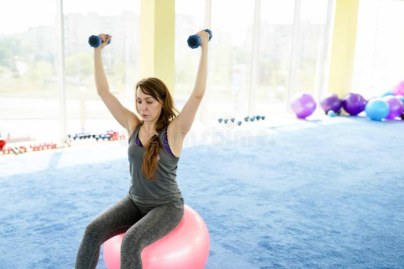 Woman fitness. beautiful Caucasian senior woman doing exercise in gym . healthy lifestyle.  stock image