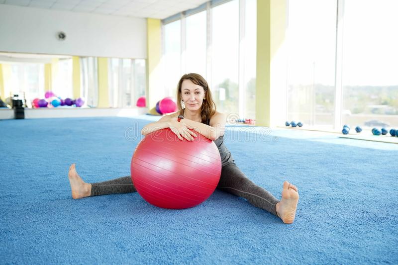 Woman fitness. beautiful Caucasian senior woman with ball in gym . healthy lifestyle. Copy space stock photo