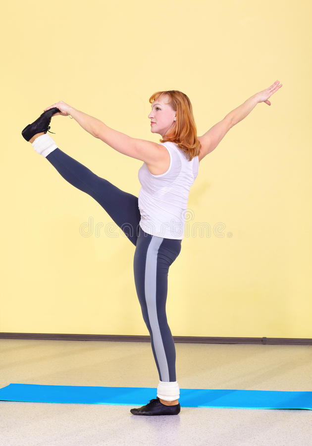 Woman on fitness carpet. Indoor portrait of woman training in gym on fitness carpet stock photos