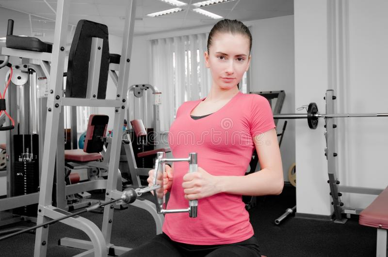 Woman in fitness center stock image