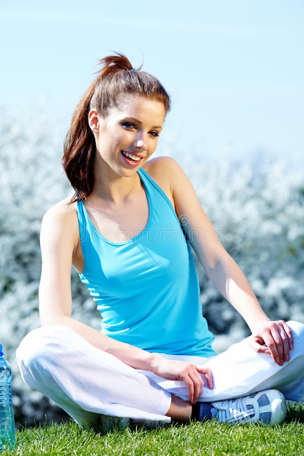 Woman in fitness clothes. Outdoor stock image