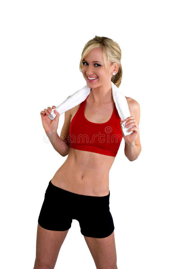 Woman in fitness clothing holding a towel royalty free stock photo