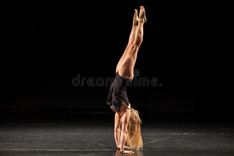 Woman fitness competition hand stand pose stock photos