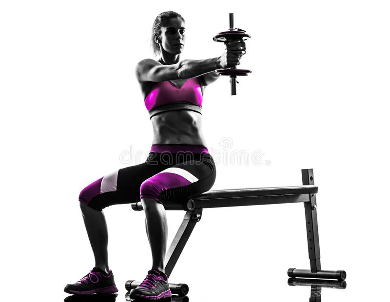 Woman fitness exercises weights body building silhouette stock image