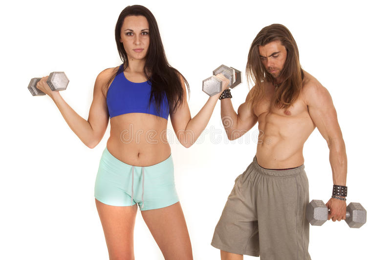 Woman fitness flex man behind curl stock images