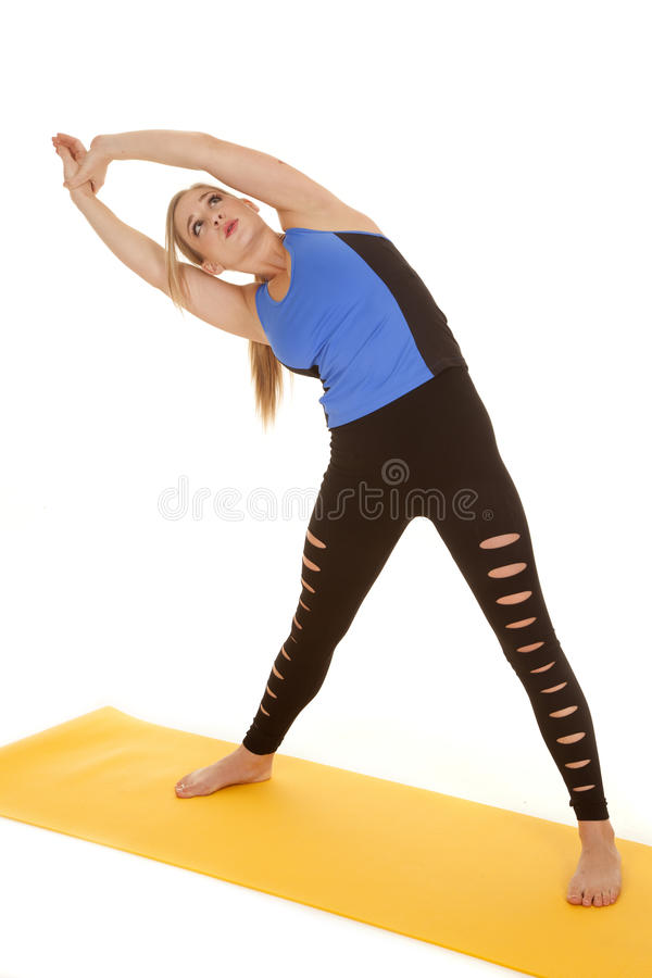 Woman fitness holy pants stretch to side. royalty free stock photography
