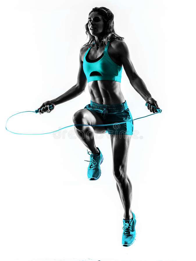 Woman fitness Jumping Rope exercises silhouette. One caucasian woman exercising Jumping Rope fitness in studio silhouette isolated on white background royalty free stock image