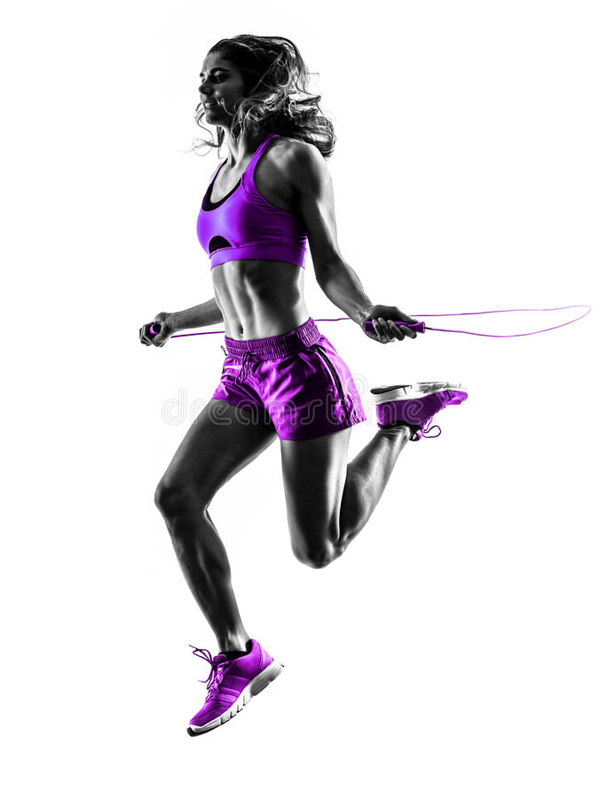 Woman fitness Jumping Rope exercises silhouette. One caucasian woman exercising Jumping Rope fitness in studio silhouette isolated on white background stock photo