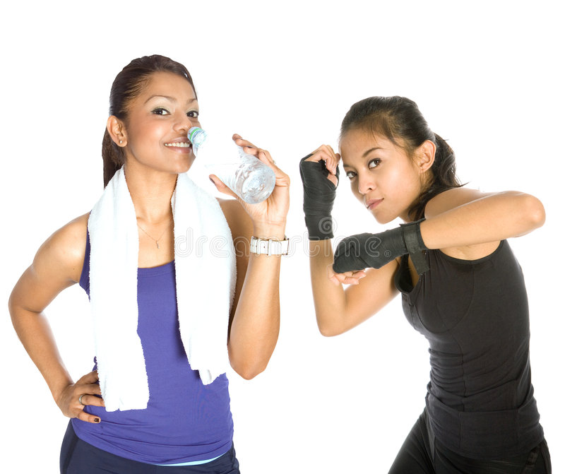 Woman fitness and rehydration. While working out royalty free stock photo