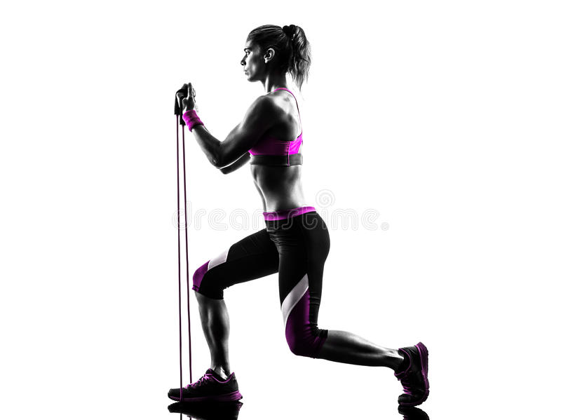 Woman fitness resistance bands exercises silhouette. One caucasian woman exercising fitness resistance bands in studio silhouette isolated on white background stock image