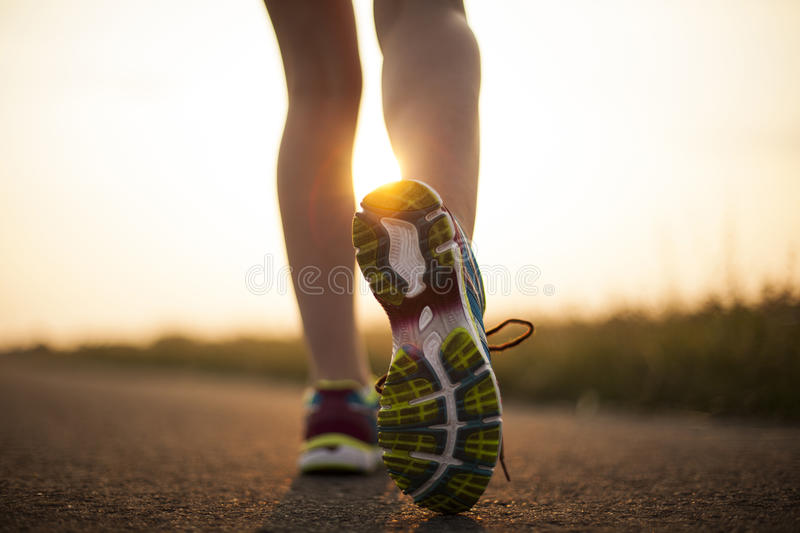 Woman fitness, Runner feet running. Training woman and healthy lifestyle royalty free stock photos