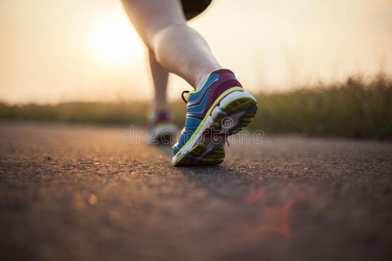 Woman fitness, Runner feet running royalty free stock photography