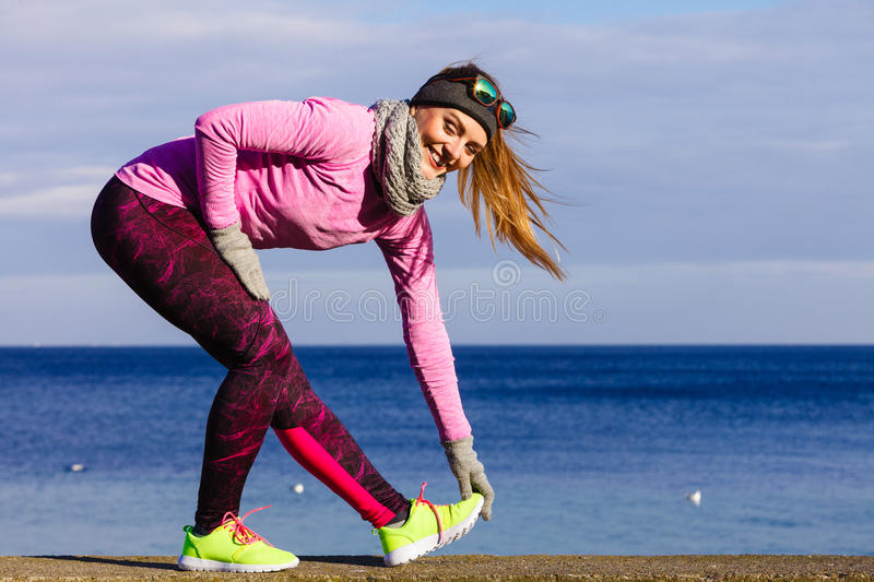 Woman fitness sport girl training outdoor in cold weather royalty free stock photos