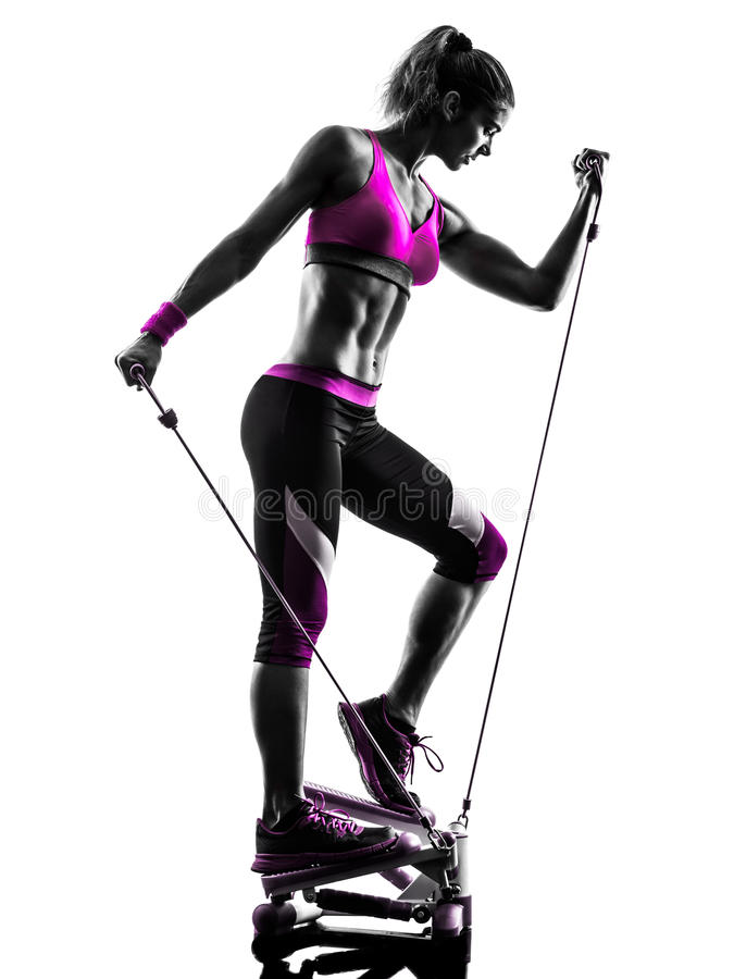 Woman fitness stepper exercises silhouette. One caucasian woman exercising stepper resistance bands fitness in studio silhouette isolated on white background royalty free stock photos