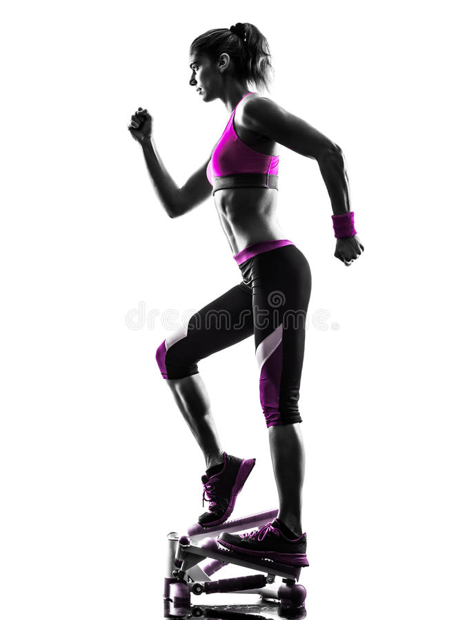 Woman fitness stepper exercises silhouette. One caucasian woman exercising stepper fitness in studio silhouette isolated on white background royalty free stock photo
