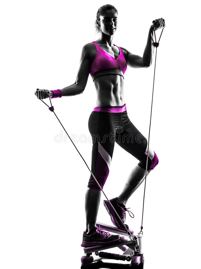 Woman fitness stepper resistance bands exercises. One caucasian woman exercising stepper resistance bands fitness in studio silhouette isolated on white royalty free stock image