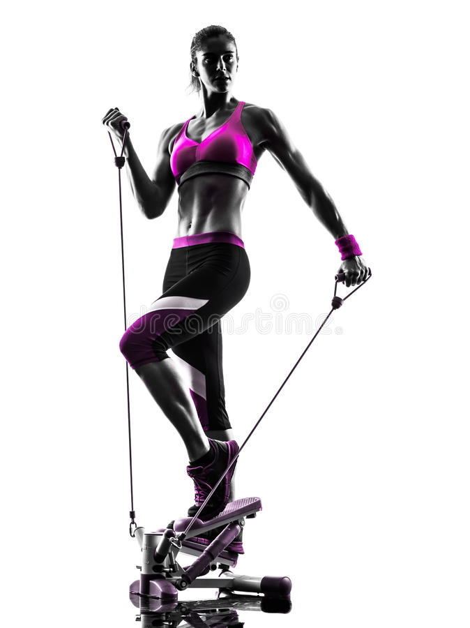 Woman fitness stepper resistance bands exercises silhouette. One caucasian woman exercising stepper resistance bands fitness in studio silhouette isolated on royalty free stock photography