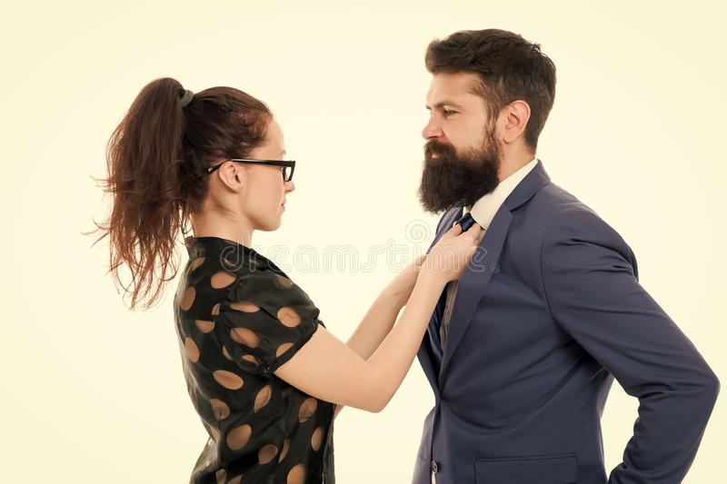 Woman fix her man bowtie. formal business couple. business with personal assistant. elegant sexy woman fixing her lovers royalty free stock photo