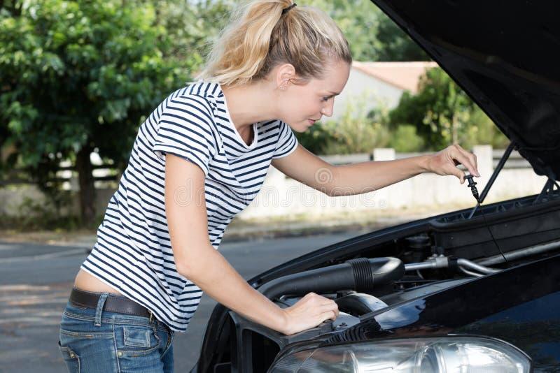 Woman fixing car alone royalty free stock photos