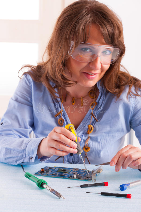 Download Woman Fixing Computer Parts Stock Photo - Image: 30619808