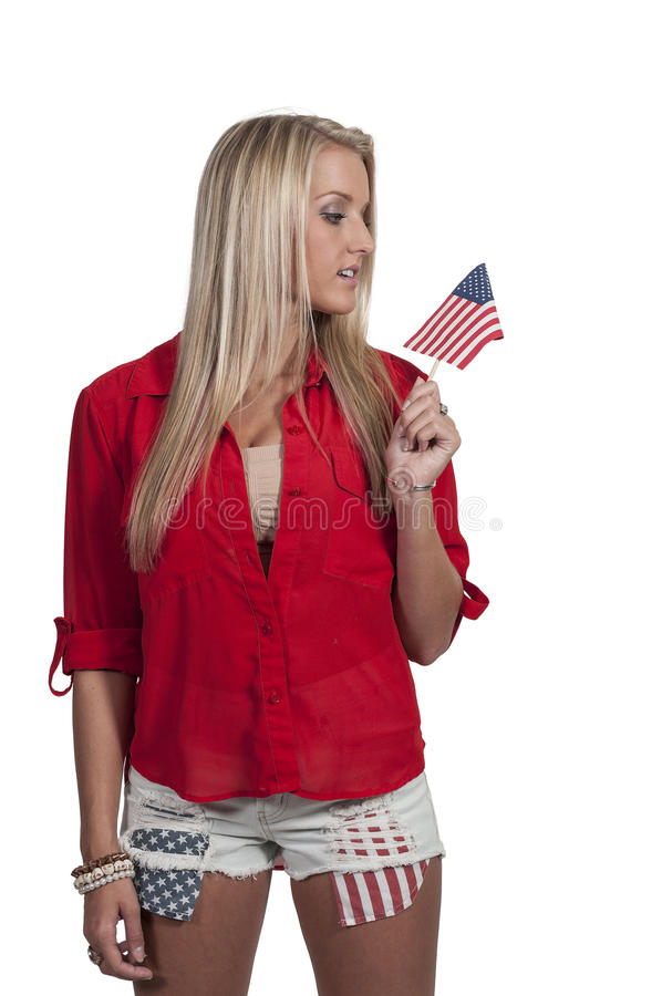 Woman with a Flag. Beautiful young woman holding an American flag stock photos